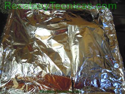 Placa para horno cubierta en papel aluminio